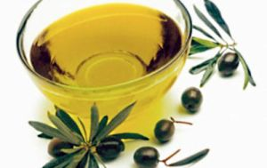 Bowl of Olive Oil --- Image by © J.Garcia/photocuisine/Corbis